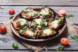 Mini pizza with eggplant , tomato and basil, aubergine
